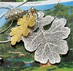 Real leaf Jewelry, Oak Leaves and Pine Cone, Gold and Silver Necklace by Natures Leaves. $29.95, via Etsy.
