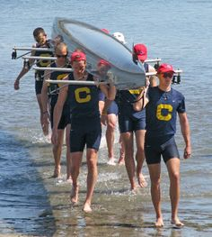 """Rowers with their boat.  Yep, these guys are from Cal!  I am a big fan of """"The Boys in the Boat"""" book........The Cal crews were certainly a big part of that story.  Had to include them on this board, even though this is not a photo from the 30's!"""