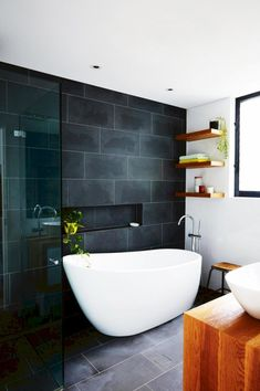 Inspiring Scandinavian Bathroom Remodel Ideas | Large Grey Floor to Ceiling Tiles - pinned by www.youngandmerri.com
