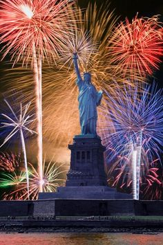 Statue of Liberty with fireworks in New York, NY