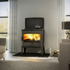 Ageless multi-fuel stove with funnel and side loading door. Multi Fuel Stove, Cast Iron, Lounge, Home Appliances, Piece, Wood, Modern, Stoves, Pallet Ideas