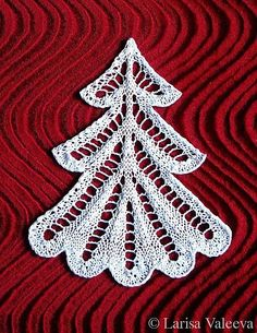 Free knitting pattern for Lace Christmas Tree Gift Topper Ornament and more gift wrap knitting patterns
