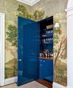 high gloss blue hidden door in wallpapered room Home Wet Bar, Diy Home Bar, Bars For Home, Wet Bar Designs, Scenic Wallpaper, California Homes, Bar Furniture, Elegant Homes, Inspired Homes