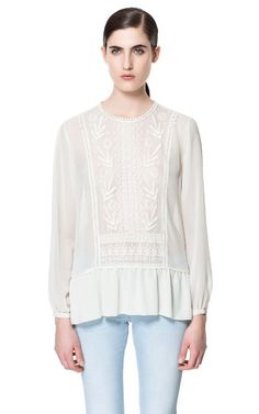 Image 1 of BLOUSE WITH EMBROIDERED FRONT from Zara