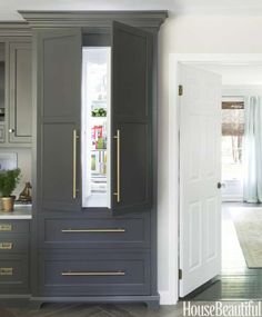 """The refrigerator blends in with the rest of the New Jersey kitchen designed by Caitlin Wilson. """"Orig... - Annie Schlechter-pulls used"""