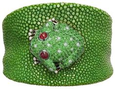 Green galuchat bracelet with a white gold frog set with 2 rubies, 289 green garnets, 10 white diamonds and 14 black diamonds by de Grisogono.  Via CIJ Jewelery Magazine.
