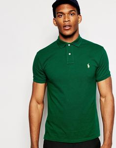 2bdb65abbf04 Polo shirt by Polo Ralph Lauren Breathable cotton pique Ribbed collar and  cuffs Embroidered polo player logo Two button placket Split, stepped hem Slim  fit ...