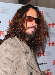 The man can rock a cardigan.<---can also rock a full beard and that goatee he always had.