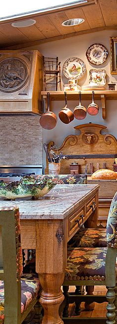 Rustic kitchen designed by Charles Faudree. Absolutely love the back wall!