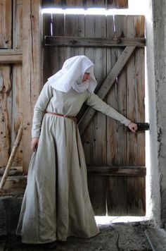 13th C outfit with gown, wimple and veil. Remember to cover your hair. Kids and hookers don't.