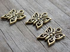 Bronze Butterfly Charms, Antiqued Bronze, 15mm, 15pcs by AliCsSupplyShop on Etsy