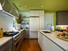Open shelving replaces upper cabinetry in the kitchen's far corner. Cabinet hardware is eliminated in places to promote the room's streamlined aesthetic.  http://www.hgtv.com/dream-home/hgtv-dream-home-2013-kitchen-pictures/pictures/page-5.html?soc=dhpp