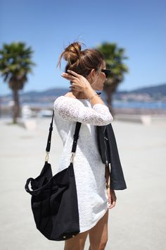 Probably the easiest way to pull off a white lace dress outfit is to accessorise it with a black bag and a black moto leather jacket. That works. Via Silvia GarciaDress/Bag: Sézane