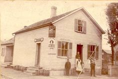 """The two corner signs on the building give us a clue to the date of the picture. The top sign is for the """"Celebrated Lager Beer"""" of Lorenz Kuenzl's Gambrinus Brewery. The lower sign is for Horn & Schwalm's Stock Lager. After 1894 these two breweries would merge with The Union Brewery to form the Oshkosh Brewing Company, so in all likelihood, the image pre-dates 1894."""