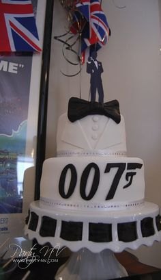 Cake for a James Bond party- it doesn't look easy but I really want to learn how to make this for my birthday!!!       Love James Bond movies