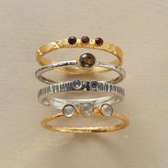 GALAXY RINGS, SET OF 4 - Universally beautiful—handcrafted bands of 14kt gold plate and sterling silver set with labradorite, garnet, iolite and smoky topaz. Exclusive. Whole sizes 5 to 10. Set of 4.