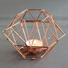 This copper geometric tealight holder is going to look so pretty at your boho chic wedding!