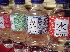 Decorated water bottles, with the Japanese character for water