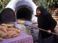 Greece - Woman Baking Bread Outdoor Wood Burning Oven This lady looks amazing! I wonder how many loaves she has made in her lifetime. Postmarked in 2011 with two Greece (Hellas) stamps featuring a blue set of stairs with a red circle Mykonos, Santorini, Paros, Empire Ottoman, Wood Burning Oven, Bread Oven, Cooking Bread, Wood Oven, Beautiful Stairs