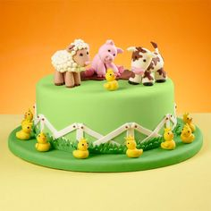 Celebrate farm-animal friends with this country-style cake, perfect for any special birthday. Topped with a lamb, pig, cow and chicks?made with our Shape-N-Amaze edible decorating dough?this cake is covered in a fenced-in green fondant pasture. Cow Cakes, Fondant Cakes, Cupcake Cakes, Farm Animal Cakes, Farm Animals, Farm Birthday Cakes, Rodjendanske Torte, Farm Cake, Barnyard Cake