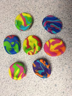 Make your own worry stones FIMO soft clay.  1. pinch of 3 colors of clay   2. roll into a ball  3. roll into a snake and coil it  4. roll into ball again  5. make a thumb print in the center  6. bake at 230 degrees for 30 min