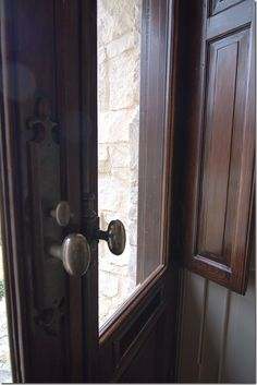 front doors with interior wood panels & pewter hardware