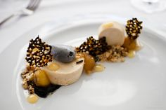 Peanut butter parfait, black sesame ice cream and tuile, caramel banana, grains
