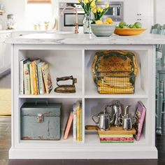 Display shelves at the end of a kitchen island boost style and function.