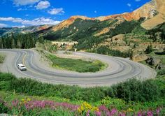 10M dollar scenic highway in Colorado from Albuquerque, NM to Montrose CO. Gorgeous scenery and hairpin turns are found on Highway 550 at Red Mountain Pass between Ouray and Silverton, CO