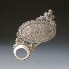 "Tamara Grüner -   Brooch ""Dorico"" 2011  Historical metal pressing, porcelain, silver, paint, steel;  10,2 x 9,0 x 1,6 cm"