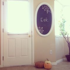 chalkboard and pumpkins in the kitchen