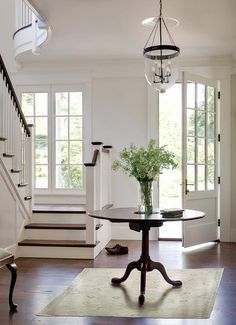 Traditional entryway with glass paned front door.