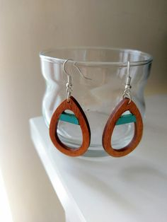 An intriguing pair of earrings, consisting of laser cut wooden teardrop shapes, with painted detail in various colours and silver plated posts. The unique materials and minimal design make these earrings simultaneously versatile and sophisticated - perfect for adding something special