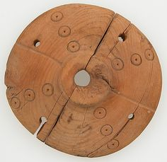 Spindle Whorl  Date: 3rd–5th century Geography: Made in, Byzantine Egypt Culture: Coptic Medium: Wood Dimensions: Overall: 7/8 x 3 1/8 in. (2.2 x 8 cm)