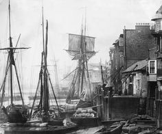 Black Eagle Wharf, Wapping, with the schooner Express of Alnmouth. On the north bank of the Thames, just below Tower Bridge, was one of the busiest waterfronts in London. As Britain's empire expanded, sea trade into London became ever busier and so more wharves and warehouses were built along the river from the Pool of London. The area began to decline with the arrival of larger steam vessels which could not sail so far up the river and which has to unload their cargoes further downstream.