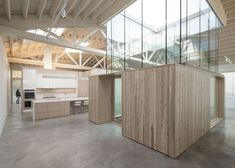 House with bowstring truss roof by Works Partnership Architecture