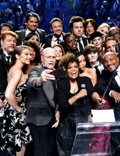 The cast of AMC's 'The Walking Dead' takes a selfie onstage during AMC's 'The Walking Dead' season 6 fan premiere event at Madison Square Garden on October 9, 2015