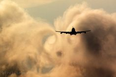 Commercial plane passing through clouds and wake turbulence