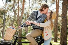 Yooniq images - Young couple kissing on bicycle