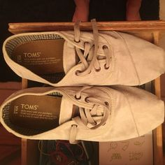 M9.5 toms light tan color lace ups I have worn them a couple of times so the heal and toe have black makes but they aren't that bad! TOMS Shoes Sneakers
