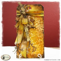 Tammy Tutterow's Thankful Tag.  The tag uses texture fades, distress ink, rock candy crackle paint, rock candy dry glitter, distress stain, die cuts and other embellishments.tammytutterow thankful 1