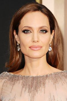 If you have long locks and want to wear it down make sure it has a healthy sheen to it. Match it, as Angelina Jolie did here, with extra long lashes, smoky eyes and nude lips for a slight Sixties feel that is still very sophisticated.