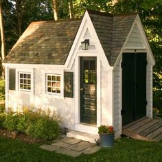 8×12 Dollhouse – Shown here with horizontal pine siding, custom door, architectural slate roof  and an electric package.