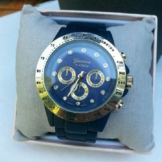 Women's Navy Geneva Platinum Watch Beautiful large-faced women's watch. Color is navy with gold accents. The style number is 9314 and it has quartz movement. Never worn and the pin is still in so it has never ticked! Geneva Other
