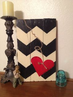 Idea! black, white, and red color combo. Not too fond of the zig-zag (chevron) pattern. Reclaimed Pallet Sign