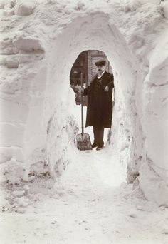 ca. 1899, [gentleman in a snow tunnel after a storm] via the Wisconsin Historical Society