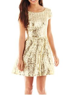 Look radiant in this sparkly gold sequined dress!: http://www.quinceanera.com/dresses/sadie-hawkins-dresses-quince-damas/?utm_source=pinterest&utm_medium=article&utm_campaign=121914-sadie-hawkins-dresses-quince-damas