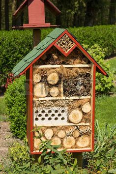 insect hotel: An insect hotel in a green landscaped garden Stock Photo