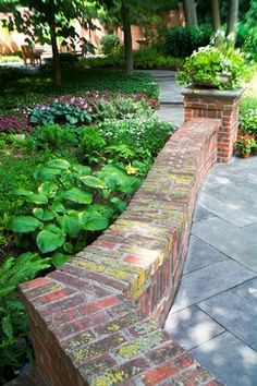 Brick garden wall with bluestone paving. ... my plan : make some of these walls for the yard, to use as benches, around the swings/firepit