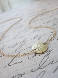 Small gold disk necklace